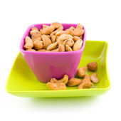 Colored bowl with cashew nuts — Stock Photo