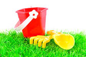 Sandpit toys on green grass — Stock Photo