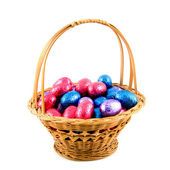 Woven basket with easter eggs — Stock Photo