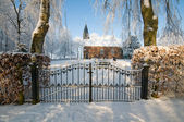 Church behind a fence in winter — Stock Photo
