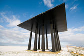 Black monument at seawall — Stock Photo