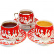 Three decorated china cups - Stock Photo