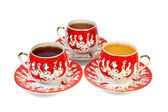 Three decorated china cups — Stock Photo