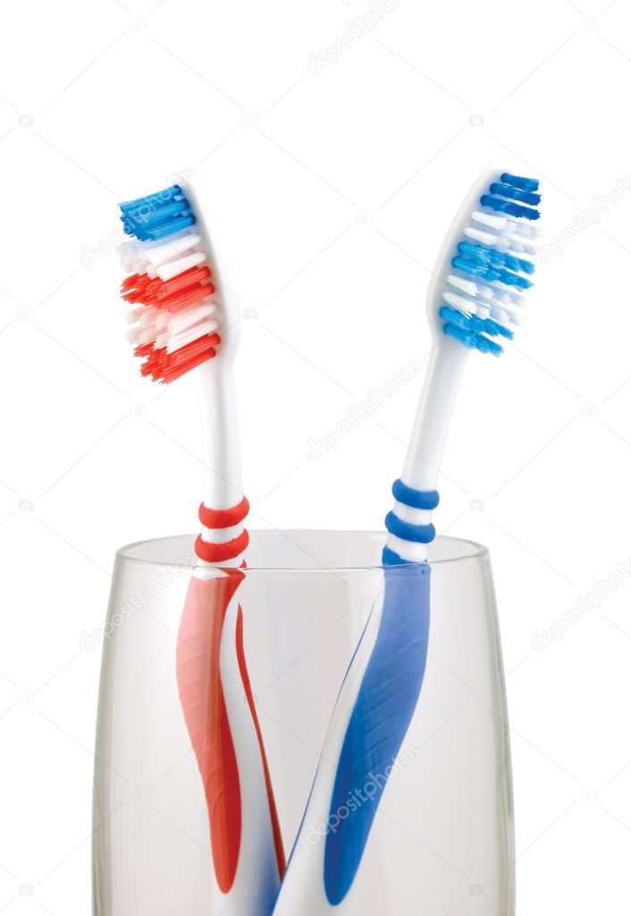 Two Toothbrushes in glass, red, blue, isolated on white — Stock Photo #2252797