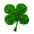 Four-leaf lucky clover made of peas - Stock Photo