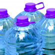 Four bottles of water isolated — Stock Photo #2307821