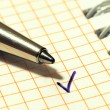 A pen and a tick mark — Stock Photo