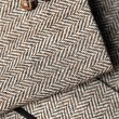 Stock Photo: Sleeve of tweed brown jacket