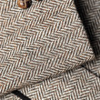 Sleeve of tweed brown jacket — Stock Photo #2308267