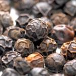 Black pepper balls close up — Stock Photo