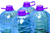 Four bottles of water isolated — Stock Photo