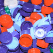 Pile of colored plastic corks — Stock Photo