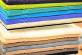 Pile of colored towels on the shelves — Stock Photo