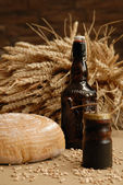Bottle of beer and bread — Stock Photo