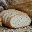 Freshly baked bread with stems of wheat — Stock Photo #2394702