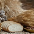 Freshly baked bread with stems of wheat and soybeans — Stock Photo #2394837