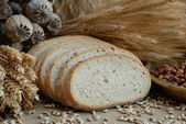 Freshly baked bread with stems of wheat — Stock Photo