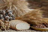 Freshly baked bread with stems of wheat and soybeans — Stock Photo