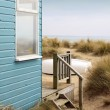 Beach Hut and Boat — Stock Photo