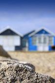 Beach Huts and Rock — Stock Photo