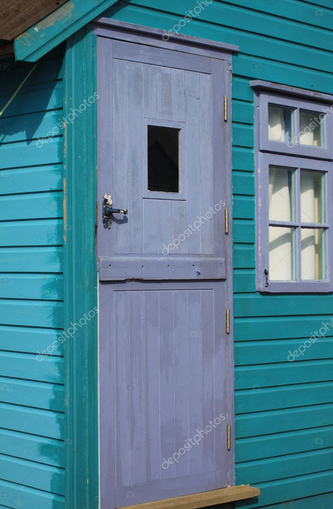 A detail of a turquoise wooden painted coastal beach hut. Location in Christchurch, Dorset Hampshire UK. — Stock Photo #2568685