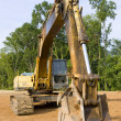 Hydraulic excavator from the front - Stock Photo