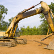 Hydraulic excavator from the side - Stock Photo
