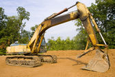 Hydraulic excavator from the side — Stock Photo