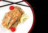 Salmon with wild rice — Stock Photo