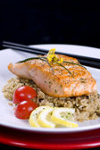 Salmon on wild rice — Stock Photo