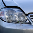 Broken headlight of the car — Stock Photo