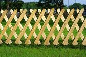Wooden trellis, grass — Stock Photo