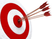 Arrows hitting directly in bulls eye — Stock Photo