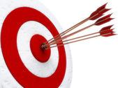 Arrows hitting directly in bulls eye — Stock Photo