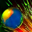 Fibers lights speeding around globe — Stock Photo