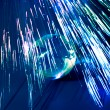 Fibers lights speeding around earth — Stock Photo #2411755
