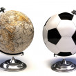 Soccer ball and globe — Stock Photo