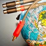 Cables near earth globe — Stock Photo