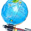 Cables near earth globe — Stock Photo