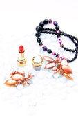 Lipstick and beads — Stock Photo