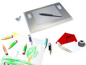 Graphic tablet with pen and coloured pen — Stock Photo