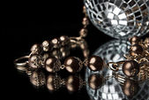Golden bead with disco ball — Stock Photo