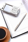 Planner with cell-phone and stylus — Stock Photo