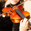 Young woman practicing her violin — Stock Photo