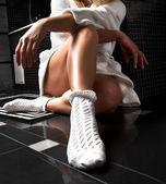 Woman legs in white socks — Stock Photo