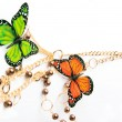 Royalty-Free Stock Photo: Golden beads with butterfly