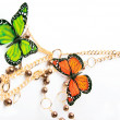 Golden beads with butterfly — Stock Photo