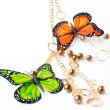 Golden beads with butterfly — Stockfoto