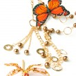 Golden beads with butterfly — Stock Photo #2575389