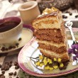 Cake with tea and gift box — Stockfoto